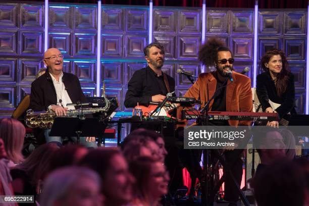 Honorary band member Malcolm Corden performs with the Late Late Show Band members Tim Young Reggie Watts and Hagar Ben Ari on The Late Late Show with...