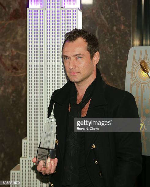 Honorary board member of Only Make Believe/recipient of the Sir Ian McKellen award for philanthropy actor Jude Law poses with a memento for lighting...