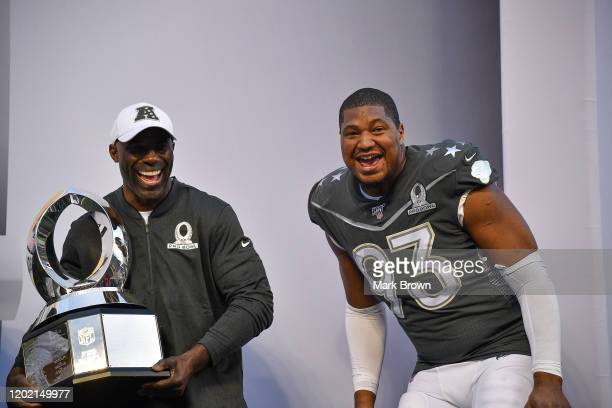 Honorary Captain Terrell Davis and Calais Campbell of the Jacksonville Jaguars celebrate after the 2020 NFL Pro Bowl at Camping World Stadium on...