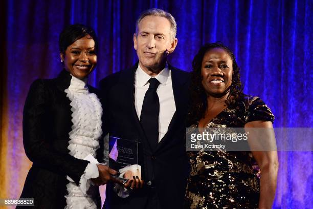 LDF honorary chair Mellody Hobson Starbucks chairman and CEO Howard Schultz and NAACP LDF president and directorcounsel Sherrilyn Ifill on stage...