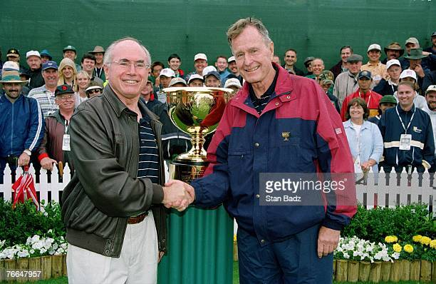 Honorary Chairman John Howard and President George H Bush during the 1998 Presidents Cup on December 1113 1998 at Royal Melbourne GC in Melbourne...