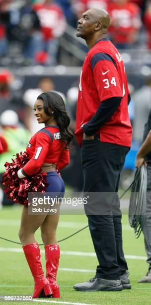Honorary cheerleader Simone Biles and Homefield Advantage Captain Hakeem Olajuwon during a game between the San Francisco 49ers v Houston Texans at...