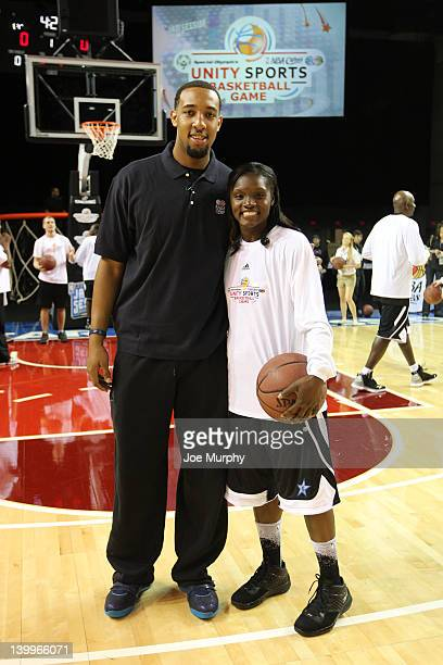 Honorary Coach Derrick Williams of the Minnesota Timberwolves poses for a photo with Marie FerdinandHarris of the Phoenix Mercury before the NBA...