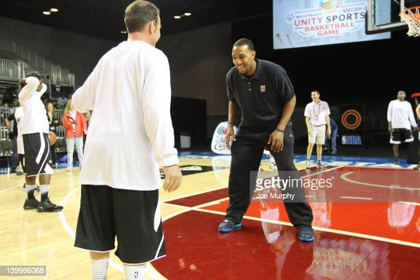 Honorary Coach Derrick Williams of the Minnesota Timberwolves runs a drill with a player before the NBA Cares/Special Olympics Unity Sports...
