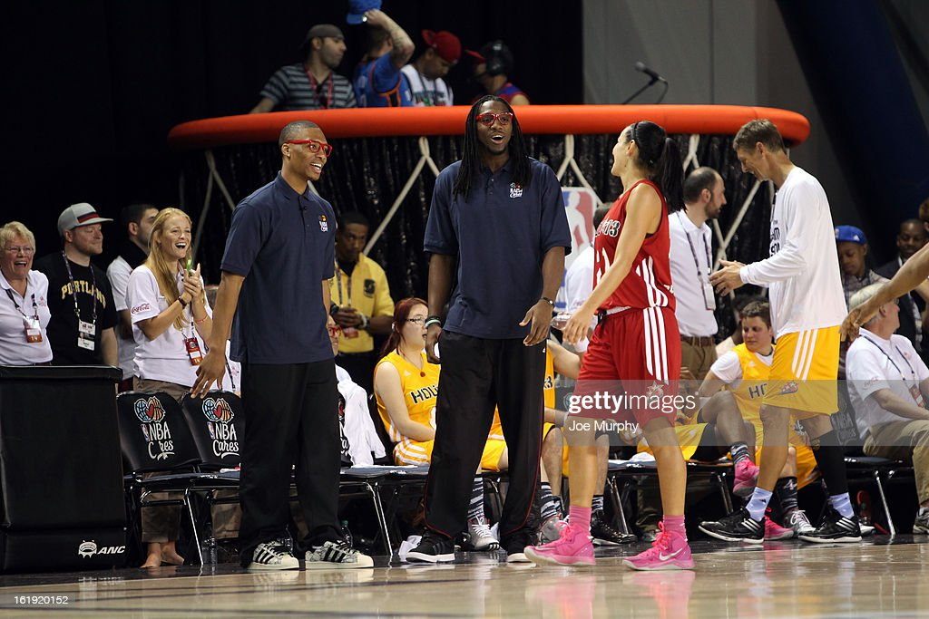 Honorary coaches Damian Lillard and Kenneth Faried talk with WNBA player Ticha Penicheiro during the NBA Cares Special Olympics Unity Sports Basketball Game on Center Court during the 2013 NBA Jam Session on February 17, 2013 at the George R. Brown Convention Center in Houston, Texas.