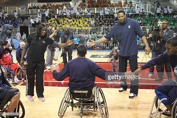 Honorary Coaches of the West team NBA Legend Robert Horry and Marie FerdinandHarris of the Phoenix Mercury high five their players before the NWBA...