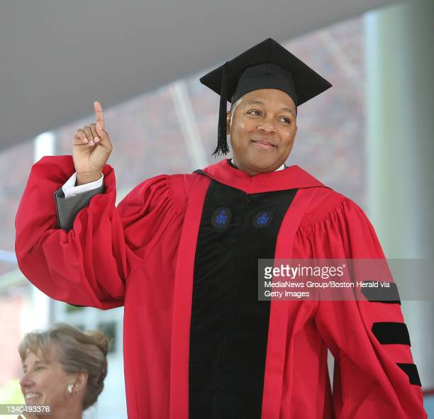 Honorary Degree Recipient Wynton Marsalis acknowledges the music as he is given his degree at the Harvard University Commencement in Harvard Yard....