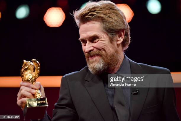 Honorary Golden Bear Winner Willem Dafoe poses with his award at the Homage Willem Dafoe Honorary Golden Bear award ceremony and 'The Hunter'...