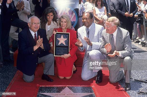 Honorary Hollywood Mayor Johnny Grant comedienne Joan Rivers and daughter Melissa Mayor Tom Bradley and television announcer Bill Welsh attend Joan...