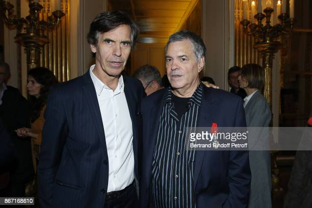 Honorary Israeli Filmmaker Amos Gitai poses with Directeur General de la Cite de la Musique Laurent Bayle at the Ministere de la Culture where he was...