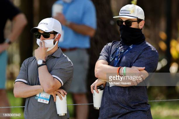 Honorary Observer and Cleveland Browns quarterback Baker Mayfield looks on as Webb Simpson of the United Stated and Paul Casey of England putt on the...
