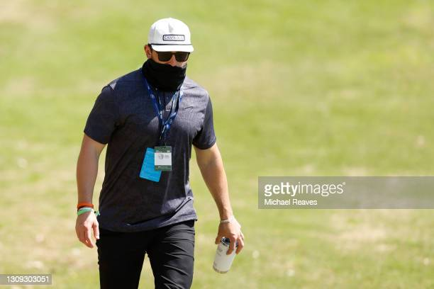 Honorary Observer and Cleveland Browns quarterback Baker Mayfield follows Webb Simpson of the United Stated and Paul Casey of England during the...