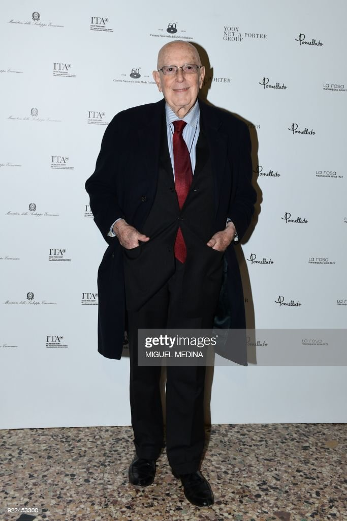 Honorary president of the Camera Nazionale della Moda Italiana (Italian Chamber of Fashion) Mario Boselli poses upon the arrival to the exhibition preview of 'Italiana, Italy Through the Lens of Fashion' at Palazzo Reale in Milan, on February 21, 2018. / AFP PHOTO / Miguel MEDINA