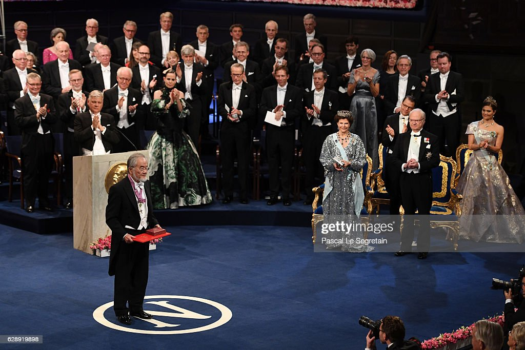 Honorary Professor Yoshinori Ohsumi, laureate of the Nobel Prize in Physiology or Medicine acknowledges applause after he received his Nobel Prize from King Carl XVI Gustaf of Sweden during the Nobel Prize Awards Ceremony at Concert Hall on December 10, 2016 in Stockholm, Sweden.