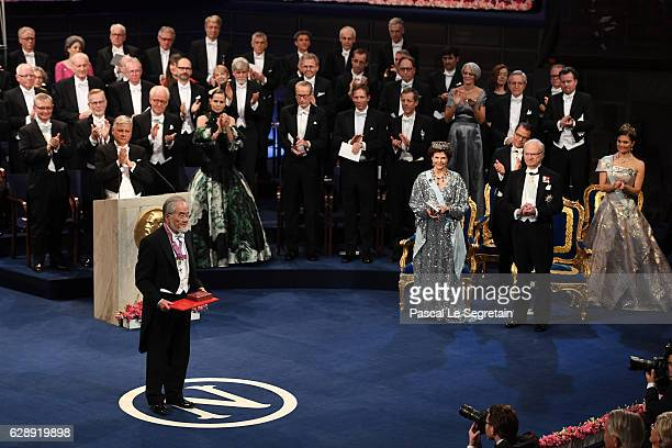 Honorary Professor Yoshinori Ohsumi, laureate of the Nobel Prize in Physiology or Medicine acknowledges applause after he received his Nobel Prize...