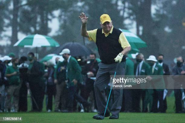 Honorary starter and Masters champion Jack Nicklaus of the United States waves after playing the opening tee shot on the first tee during the first...