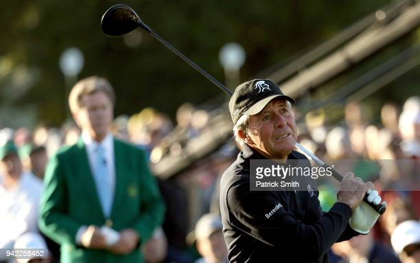 Honorary starter Gary Player of South Africa plays a shot on the first tee during the opening tee ceremony during the first round of the 2018 Masters...