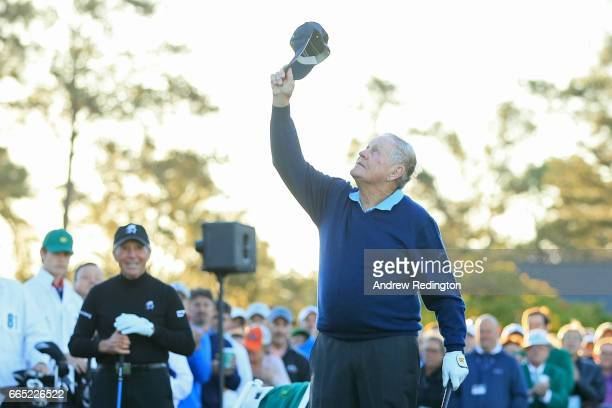Honorary starter Jack Nicklaus holds up his hat as Gary Player looks on during the first tee ceremony prior to the first round of the 2017 Masters...