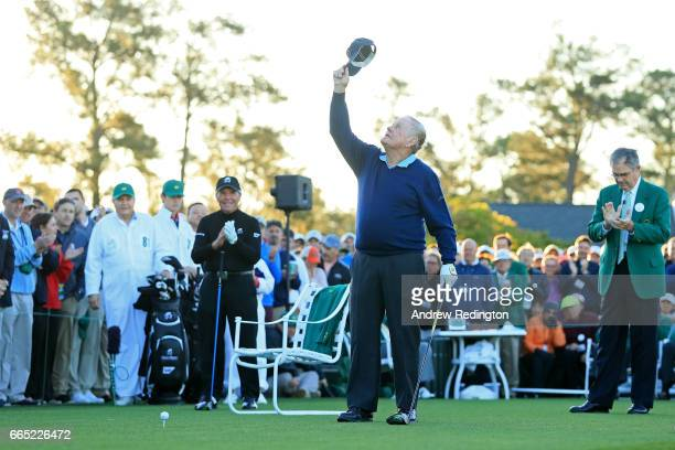 Honorary starter Jack Nicklaus holds up his hat as Honorary starter Gary Player and Chairman of Augusta National Golf Club William Porter 'Billy'...