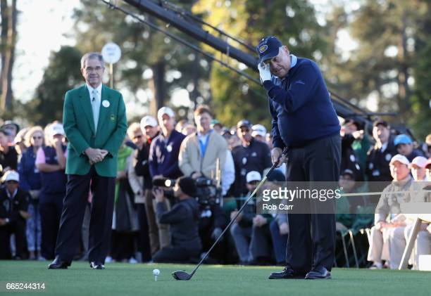 Honorary starter Jack Nicklaus plays his shot as Chairman of Augusta National Golf Club William Porter 'Billy' Payne looks on during the first tee...