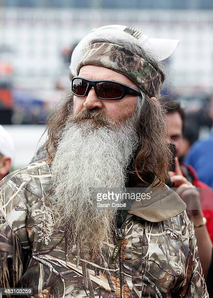 Honorary Starter reality TV personality Phil Robertson takes part in prerace ceremonies for the NASCAR Sprint Cup Series Duck Commander 500 at Texas...