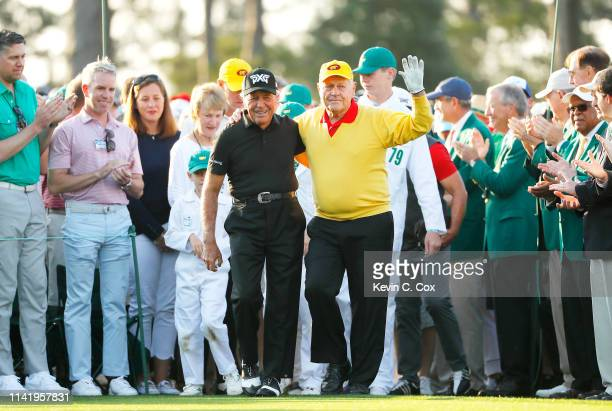 Honorary starters and Masters champions Gary Player of South Africa and Jack Nicklaus stand on the first tee during the first round of the Masters at...
