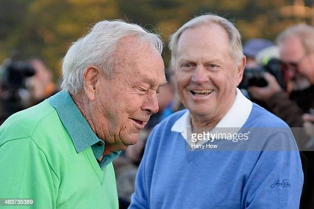 Honorary starters Arnold Palmer and Jack Nicklaus wait on the first tee at the start of the first round of the 2014 Masters Tournament at Augusta...