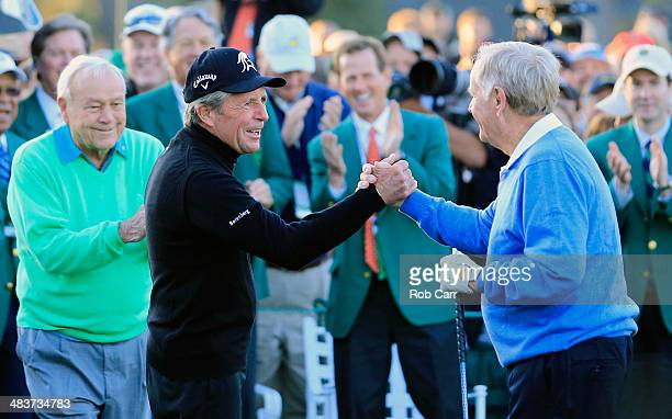 Honorary starters Arnold Palmer Gary Player and Jack Nicklaus greet each other on the first tee at the start of the first round of the 2014 Masters...