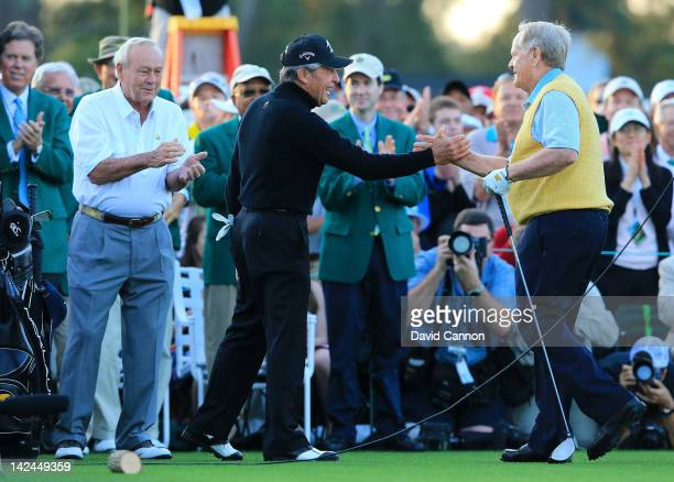 Honorary starters Arnold Palmer Gary Player of South Africa and Jack Nicklaus stand on the tee box at the start of the first round of the 2012...
