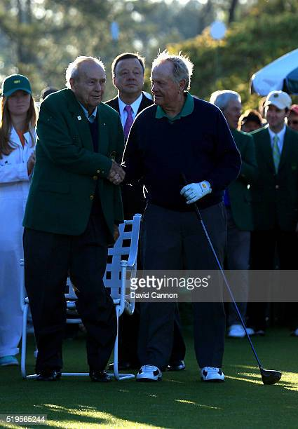 Honorary starters Jack Nicklaus and Arnold Palmer shake hands during the ceremonial tee off to start the first round of the 2016 Masters Tournament...