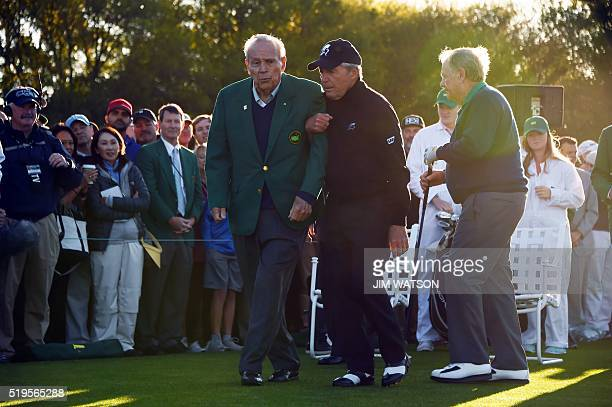 Honorary starters US golfer Arnold Palmer , South Africas Gary Player and Jack Nicklaus of the US arrive to begin Round 1 of the 80th Masters Golf...