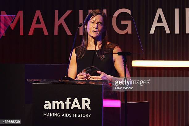 Honoree Aileen Getty speaks onstage during the 2013 amfAR Inspiration Gala Los Angeles presented by MAC Viva Glam at Milk Studios on December 12 2013...