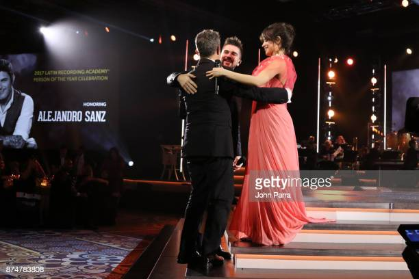 Honoree Alejandro Sanz greets Juanes and Camila Cabello onstage during the 2017 Person of the Year Gala honoring Alejandro Sanz at the Mandalay Bay...