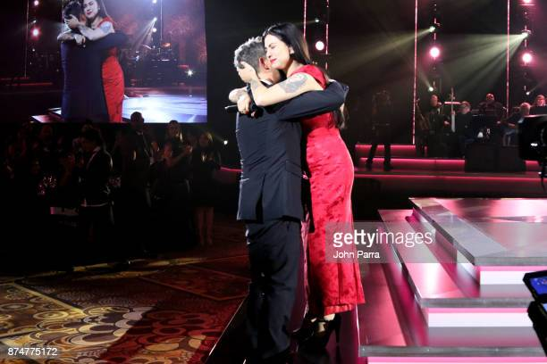 Honoree Alejandro Sanz greets Mon Laferte onstage during the 2017 Person of the Year Gala honoring Alejandro Sanz at the Mandalay Bay Convention...