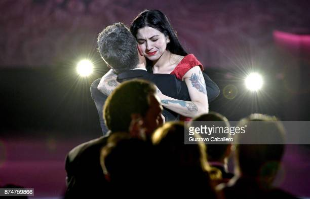 Honoree Alejandro Sanz hugs Mon Laferte during the 2017 Person of the Year Gala honoring Alejandro Sanz at the Mandalay Bay Convention Center on...