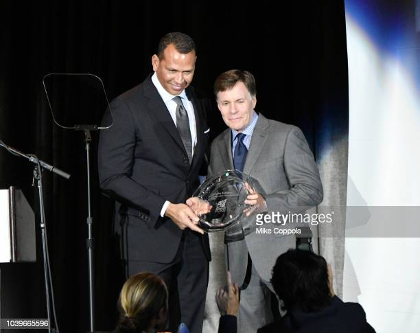 Honoree Alex Rodriguez and Master of Ceremonies Bob Costas pose with the Sports Legend award during the 33rd Annual Great Sports Legends Dinner which...