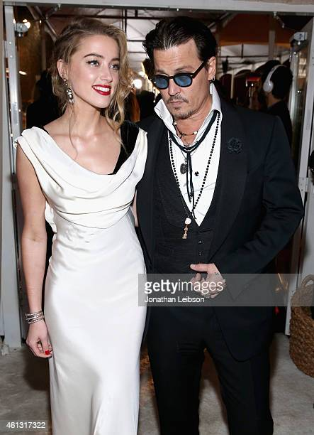 Honoree Amber Heard and actor Johnny Depp attend the 8th Annual HEAVEN Gala presented by Art of Elysium and Samsung Galaxy at Hangar 8 on January 10...