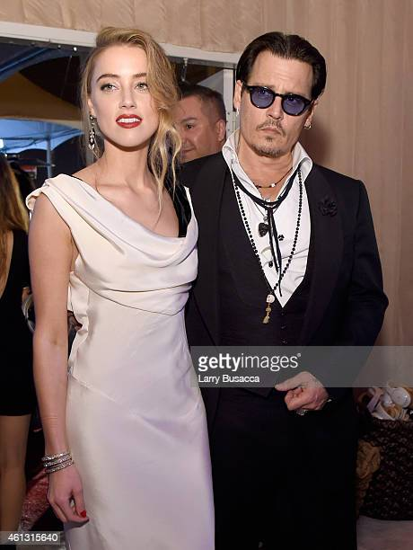 Honoree Amber Heard and actor Johnny Depp attend the Art of Elysium and Samsung Galaxy present Marina Abramovic's HEAVEN at GREY GOOSEsupported Art...