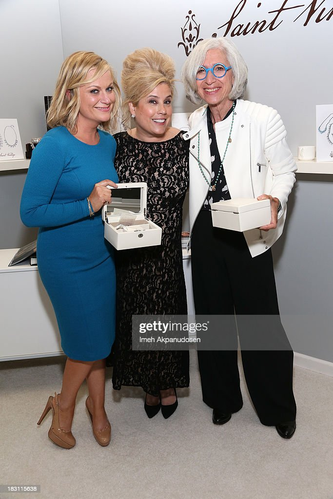 Honoree Amy Poehler, jewelry designer Paige Jansen-Nichols, and Worldwide Orphans Foundation founder Jane Aronson attend Variety's 5th Annual Power of Women event presented by Lifetime at the Beverly Wilshire Four Seasons Hotel on October 4, 2013 in Beverly Hills, California.