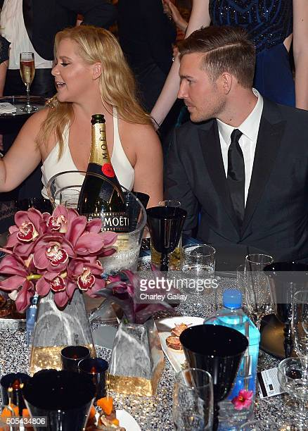Honoree Amy Schumer and designer Ben Hanisch at the 21st Annual Critics' Choice Awards presented by FIJI Water at Barker Hangar on January 17 2016 in...