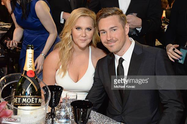 Honoree Amy Schumer and designer Ben Hanisch attend the 21st Annual Critics' Choice Awards at Barker Hangar on January 17 2016 in Santa Monica...