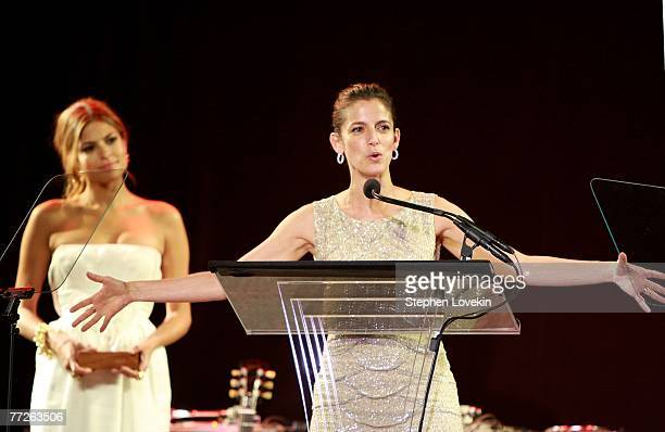 Honoree and Editor in Cheif Glamour Magazine Cindy Leive speaks onstage while actress Eva Mendes looks on during the Heart Of Gold Ball to benefit...