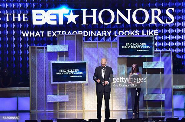 Honoree and Former Attorney General of the United States Eric Holder accepts an award presented by Melissa HarrisPerry on stage during the BET Honors...