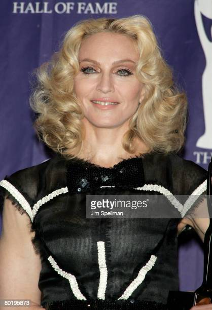Honoree and musician Madonna poses in the press room during the 23rd Annual Rock and Roll Hall of Fame Induction Ceremony at the Waldorf Astoria on...