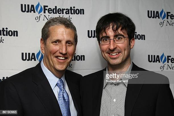 Honoree and President of MTV Networks Entertainment Group Doug Herzog and comedian John Oliver pose for a photograph at the UJA Federation event to...