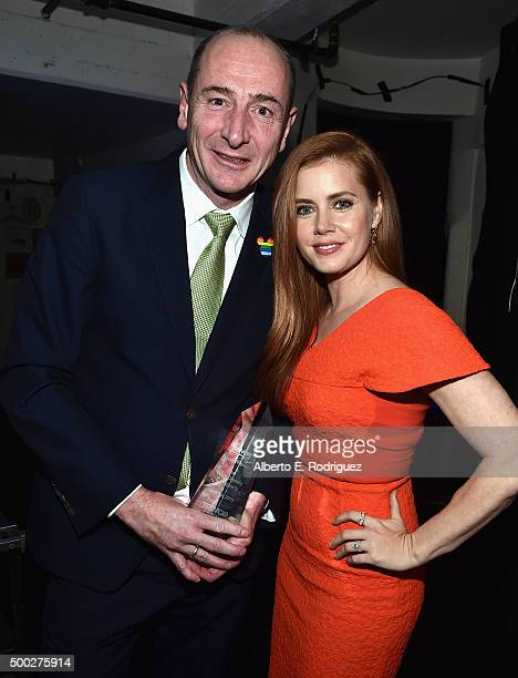 Honoree Andy Bird and actress Amy Adams pose with the Trevor 20/20 Visionary Award during TrevorLIVE LA 2015 at Hollywood Palladium on December 6...