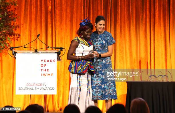 Honoree Anna Nimiriano of The Juba Monitor accepts her award from Host Cecilia Vega during The International Women's Media Foundation's 2019 Courage...