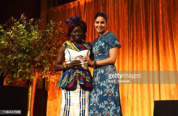 Honoree Anna Nimiriano of The Juba Monitor poses with her award and Host Cecilia Vega during The International Women's Media Foundation's 2019...