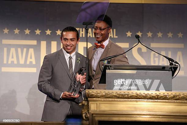 Honoree army veteran Daniel Rodriguez and army veteran Tracey CooperHarris pose on stage at the 9th Annual IAVA Heroes Gala at the Cipriani 42nd...
