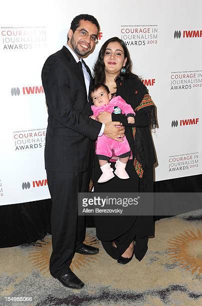 Honoree Asmaa alGhoul and family arrive at the 2012 Courage in Journalism Awards hosted by the International Women's Media Foundation held at the...